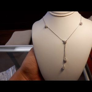 18k solid white gold stamped dangling diamond.